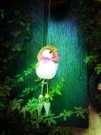 figurine oiseau blanc devant le volet vert de l'atelier du jardin, Plancher bas mai 2013